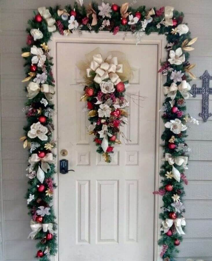 Christmas party decorated with flowers balls and ties for doorway Photo Pinterest