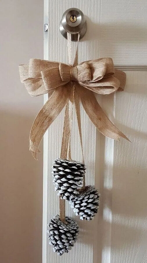 Handle decorated with Christmas ornament of pinecones Photo Magazine Handicraft