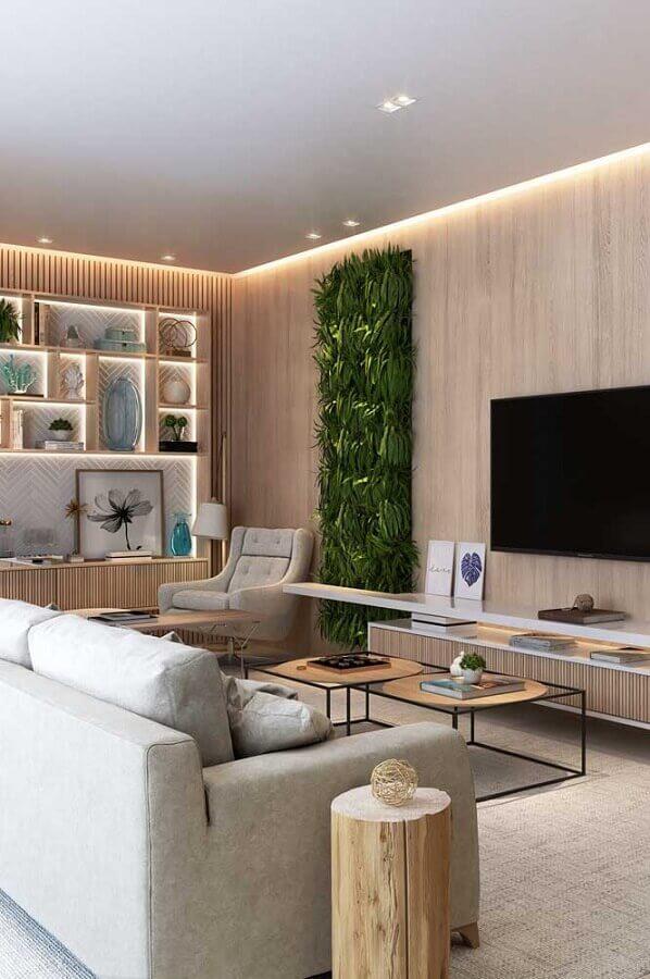 mesa de canto redonda madeira para sala moderna com jardim vertical Foto Pinterest