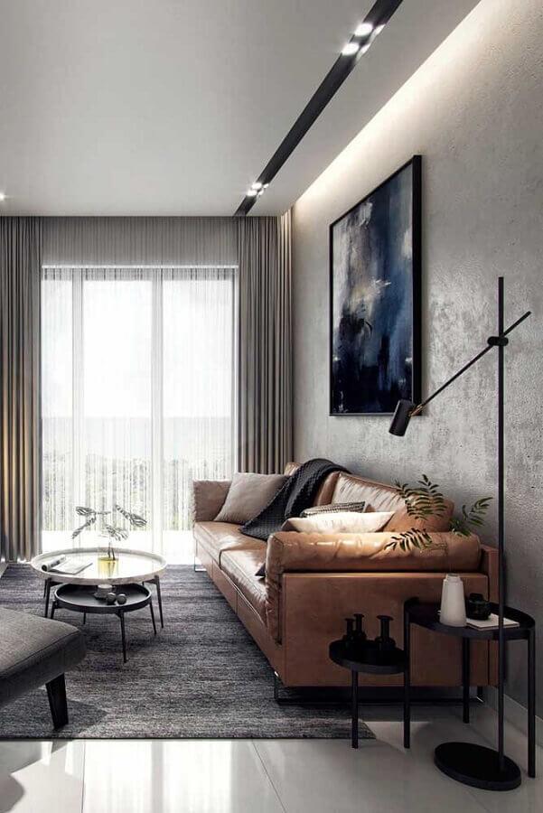 mesa de canto redonda preta para decoração de sala moderna com sofá de couro e parede de cimento queimado Foto Futurist Architecture