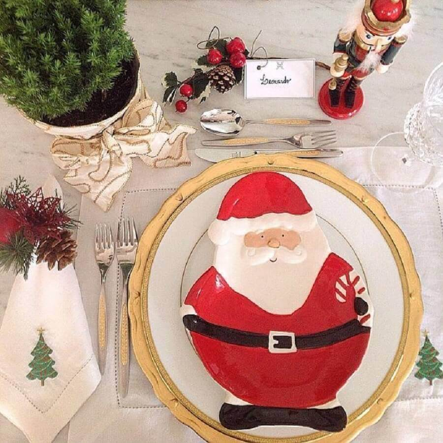 Christmas table decorated with Santa Claus themed plate Photo Style and Home