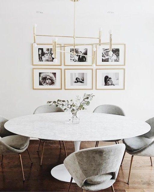 Decoração de sala de jantar com mesa saarinen