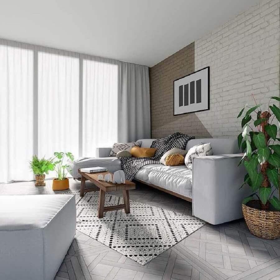 parede de tijolinho com pintura geométrica para decoração de sala branca  Foto Redecor Designer