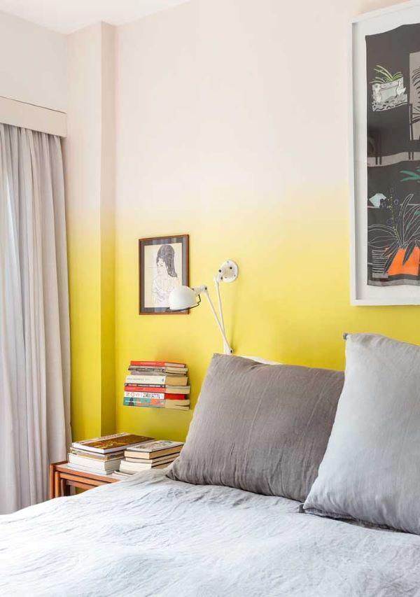 Quarto amarelo pastel em degradê da parede
