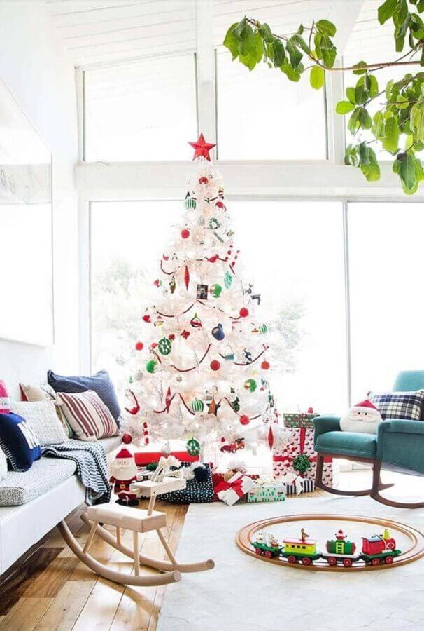 clean room decorated with large white Christmas tree with colorful decorations Photo Fresh IDEEN