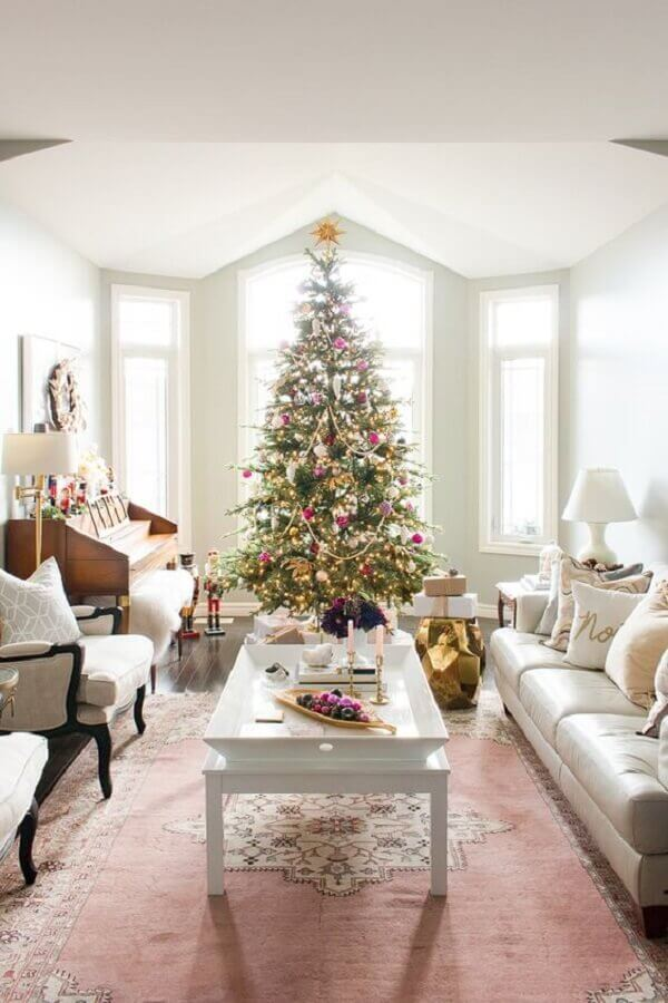 clean room decorated with white sofa and large Christmas tree Photo Elliven Studio