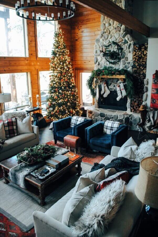 room with rustic details decorated with large and full Christmas tree Photo One Kings Lane