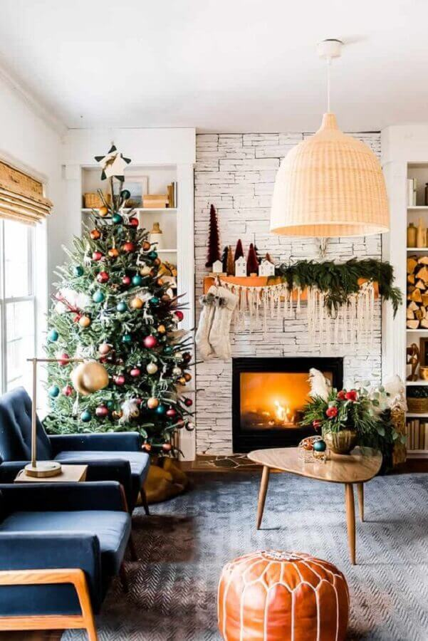 living room with large Christmas tree decorated with colorful balls Photo Apartment Therapy