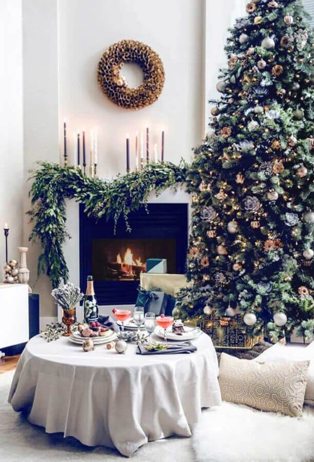 living room with fireplace decorated with large and full Christmas tree Photo Home Furniture