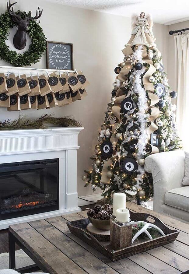 living room decorated with large Christmas tree with angel on the tip Photo Pinterest