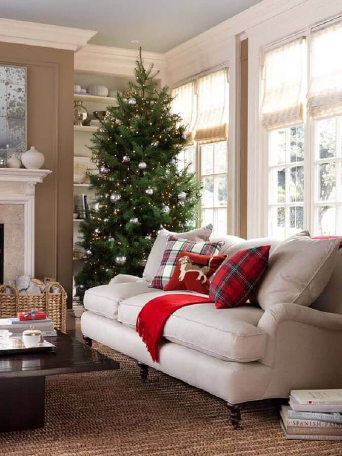 living room decorated with large Christmas tree with silver balls Photo Pinterest