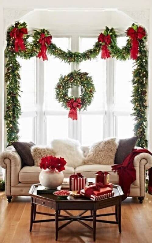Christmas party room decorated with red bows Photo Witty Bash