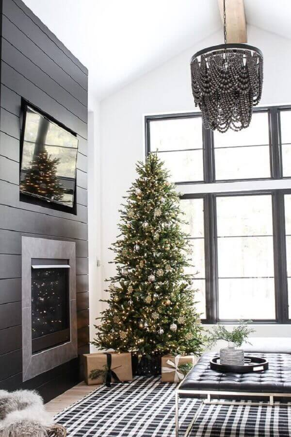 Modern grey room decorated with large Christmas tree Photo Home with Holliday