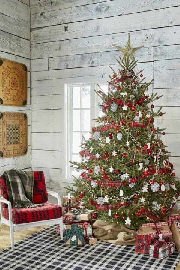 Simple room decorated with big Christmas tree Photo One Kindesign