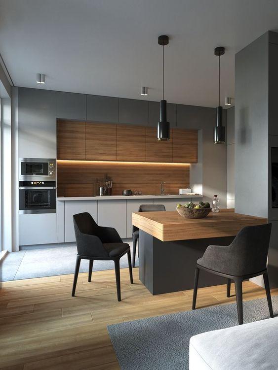 Cozinha cinza com torre quente no canto