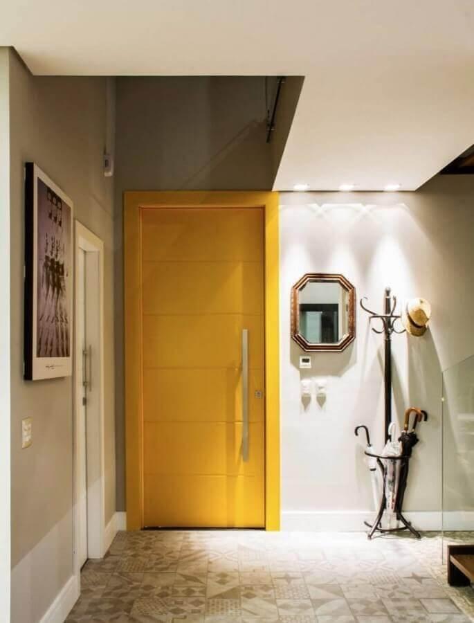 decoração de hall de entrada pequeno com espelho e cabideiro de chão Foto Pinterest