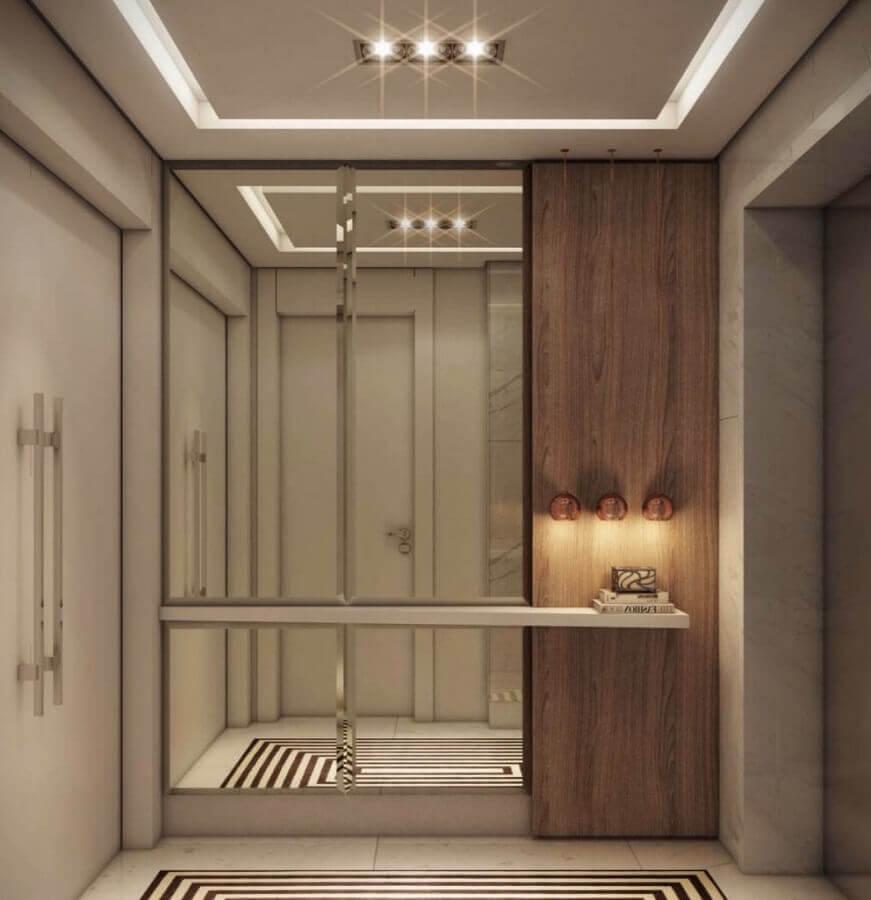decoração de hall de entrada planejado com parede espelhada Foto Home Fashion Trend
