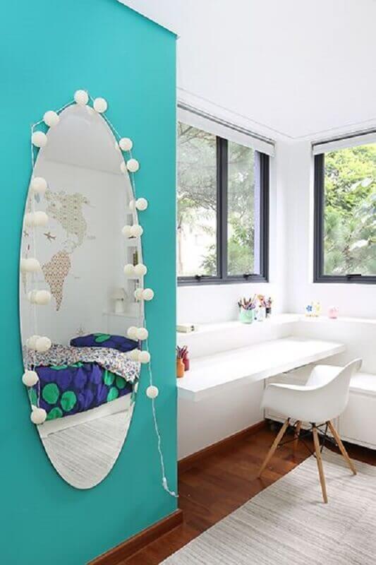 decoração de quarto com espelho grade de parede oval Foto Rúbia M. Vieira Interiores