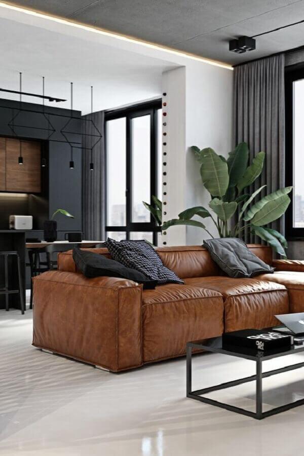 decoração moderna para sala com sofá marrom e mesa de centro preta Foto Behance