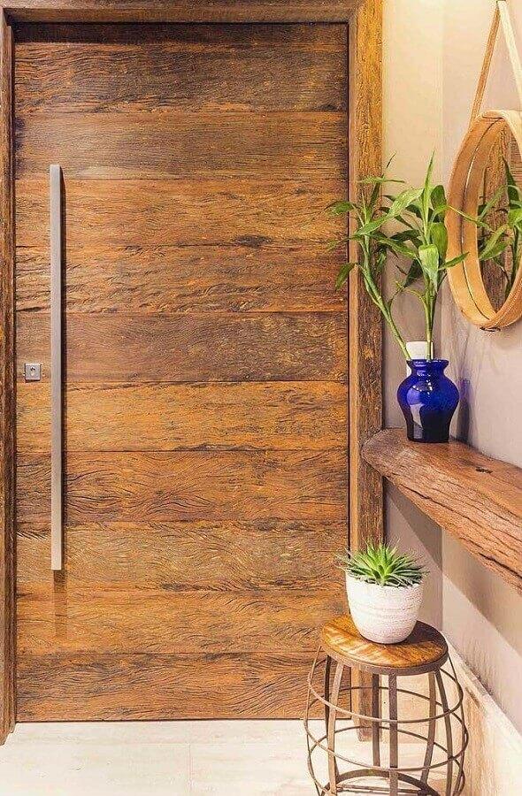 decoração rústica para hall de entrada com espelho redondo e aparador suspenso em madeira de demolição Foto My Desired Home