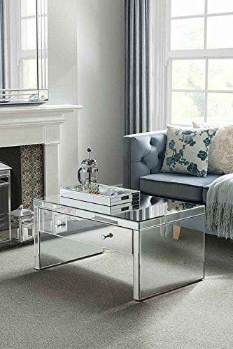 Mesa espelhada de centro com decoração sofá azul