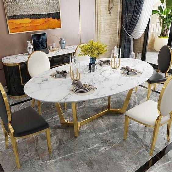 Mesa oval de mármore com detalhes em dourado