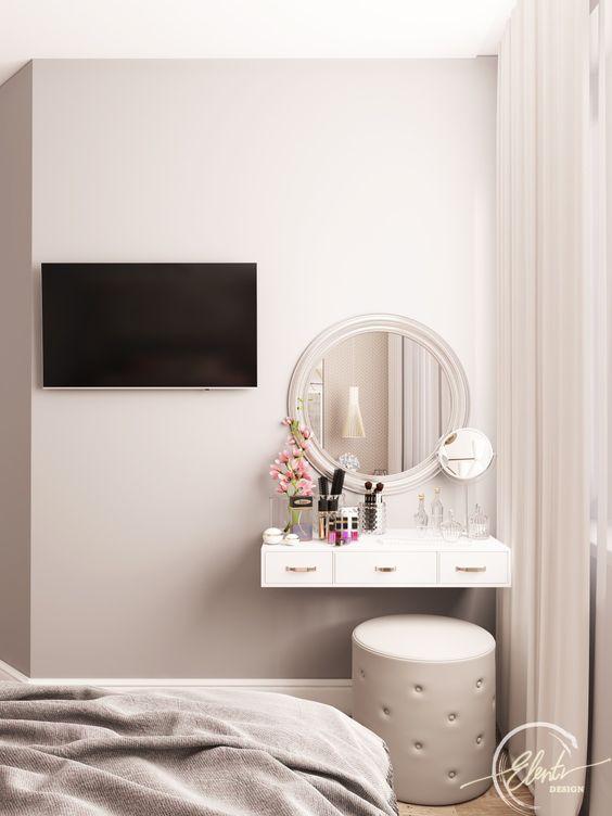 Quarto simples com penteadeira no canto