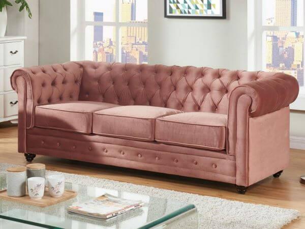 Sofá rosa antigo capitonê