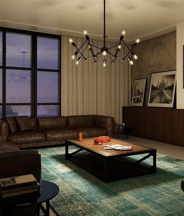 O lustre industrial é o grande protagonista da sala de estar
