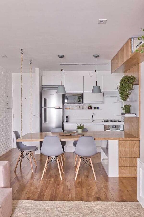 bancada de madeira planejada para decoração de cozinha e sala de jantar integradas Foto VOA Arquitetura