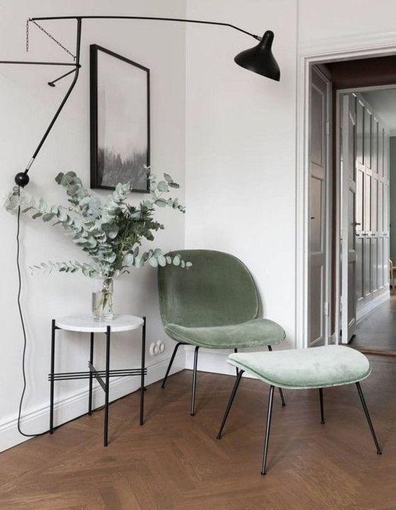 Cantinho da leitura com poltrona verde