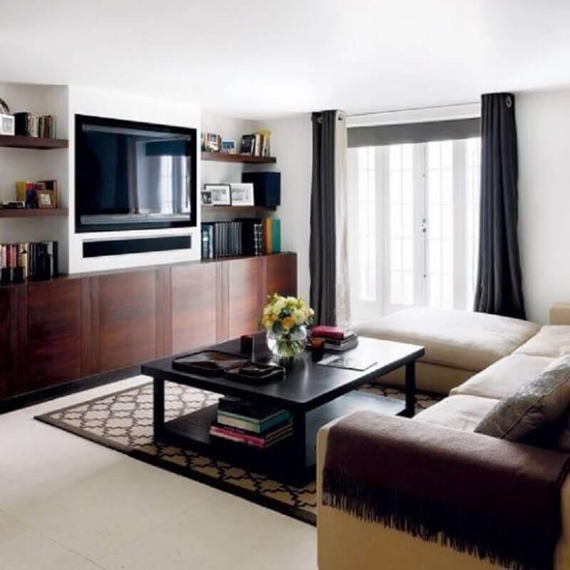 decoração de sala de tv com mesa de centro preta  Foto Dcore Você