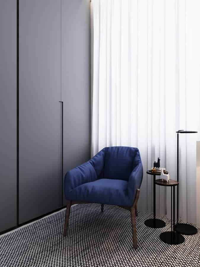 decoração minimalista com poltrona azul escuro Foto Behance