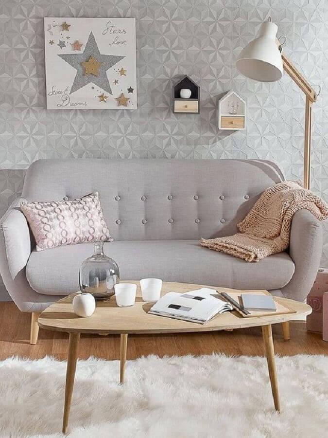 decoração retrô para sala cinza com sofá pequeno Foto Real Simple