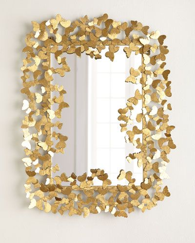 Espelho com detalhes de borboletas douradas