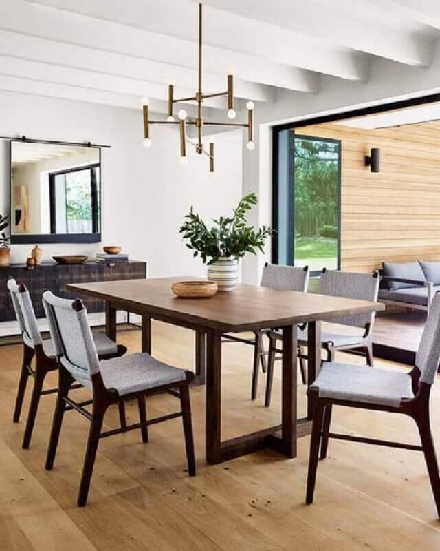 lustre pendente moderno e vasos decorativos para sala de jantar Foto Horchow
