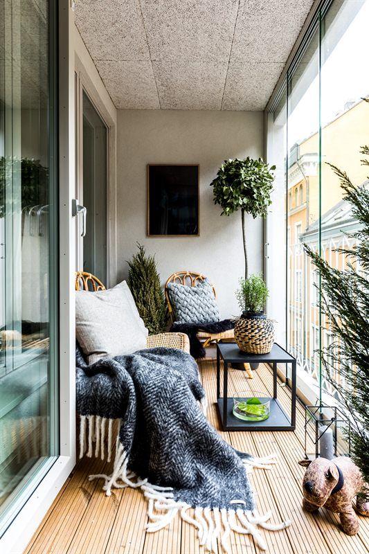 Manta para poltrona na varanda decorada