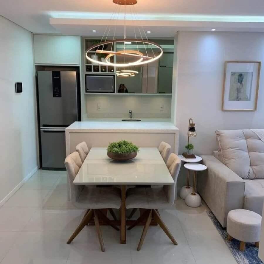 mesa de jantar integrada à bancada da sala de estar e cozinha integradas Foto 2M Interiores
