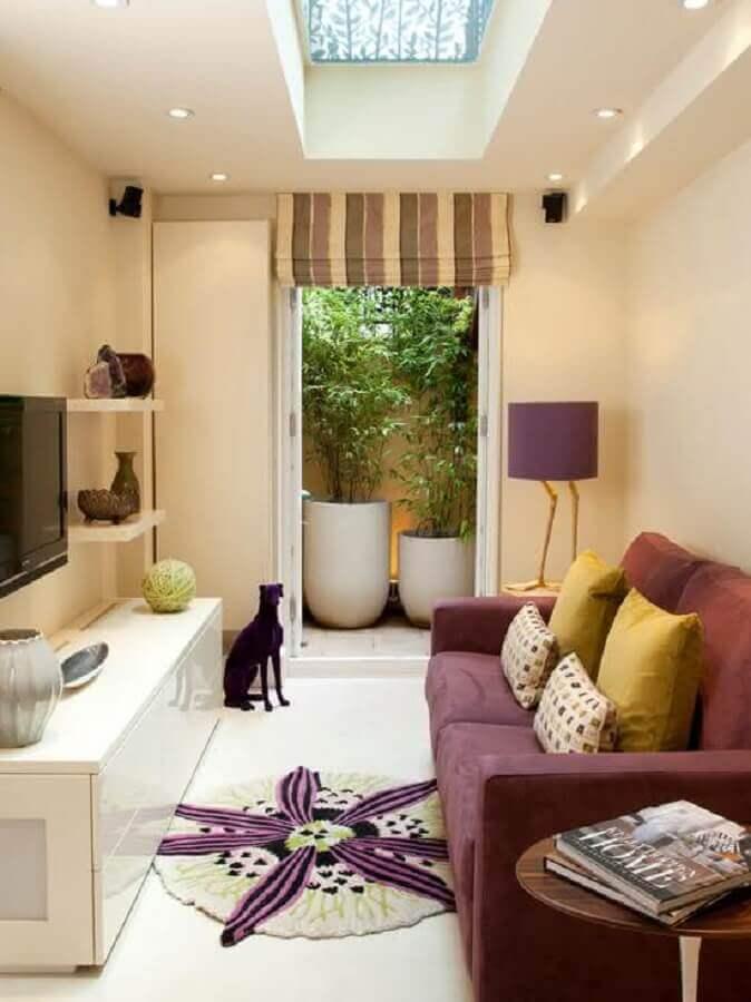 sala de TV moderna decorada com sofá pequeno confortável Foto Dcore Você