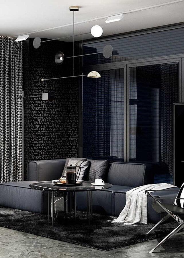 Sala preta moderna com sofá de canto