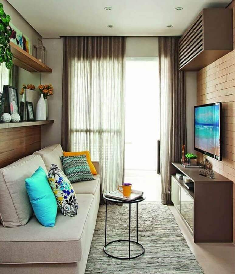 sofá para sala pequena decorada com parede tijolinho Foto Pinterest