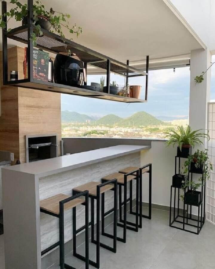 varanda gourmet pequena com churrasqueira em apartamento com decoração industrial Foto Dcore Você
