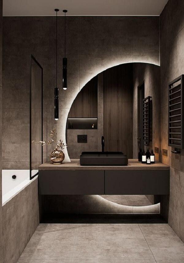O espelho redondo com LED deixa a bancada do banheiro ainda mais elegante