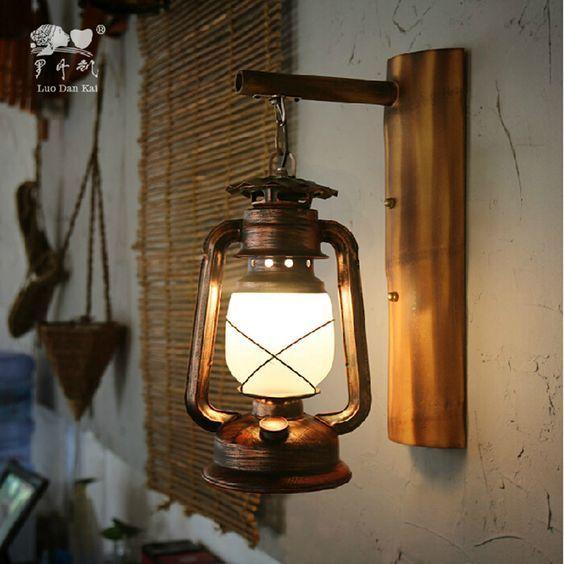Arandela rústica em casa feita com lampião
