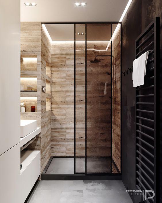 Banheiro amadeirado com detalhes em preto