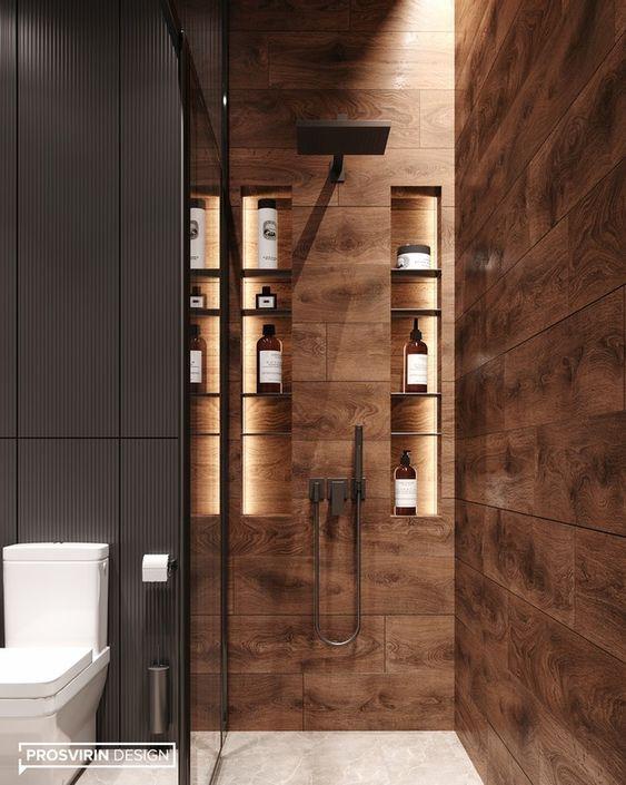 Banheiro amadeirado com ducha preta