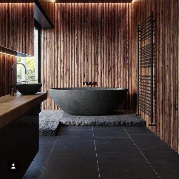 Banheiro amadeirado com preto