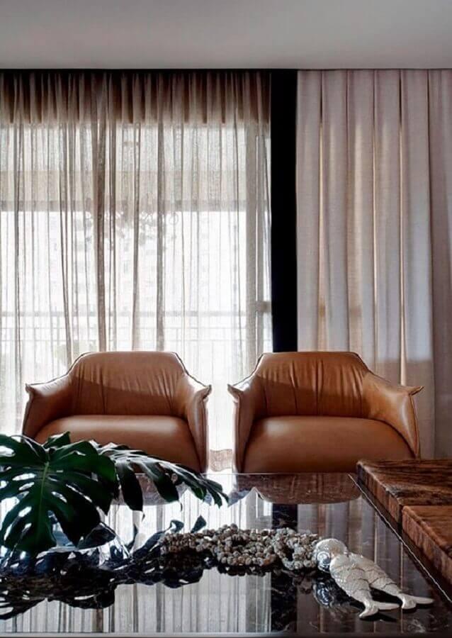 decoração com poltrona de couro para sala de estar Foto RP Estúdio