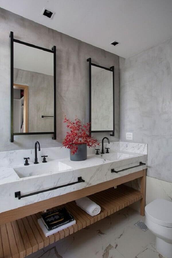 decoração moderna com cimento queimado e espelho para banheiro com moldura Foto Tripper Arquitetura