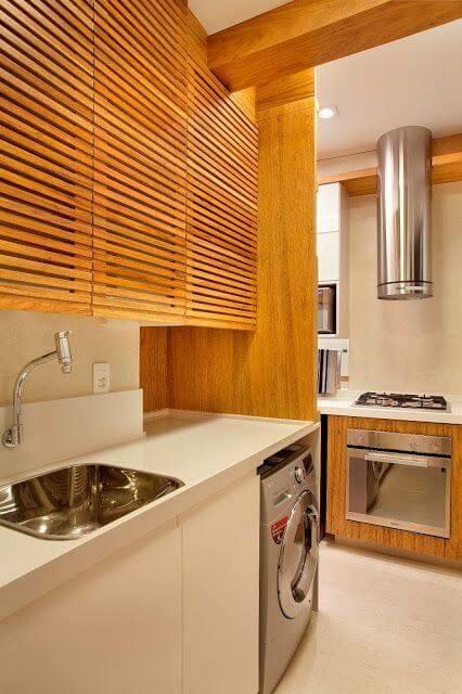 Decoração lavanderia planejada com móveis de madeira
